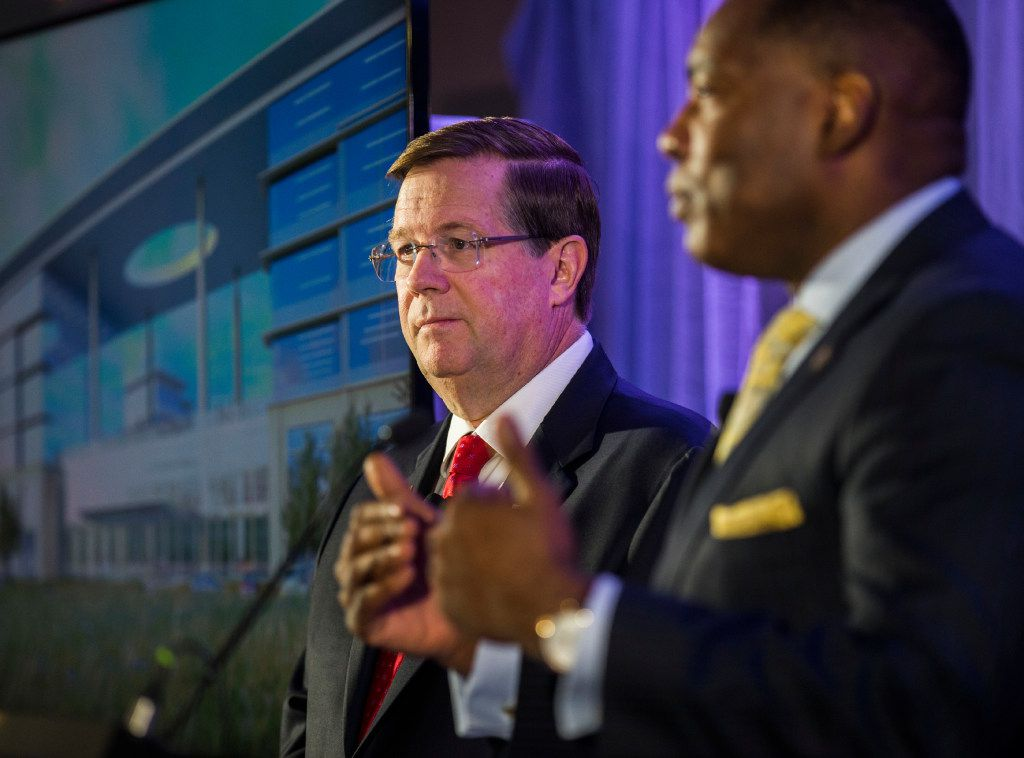 Jim Lentz (left), CEO of Toyota Motor North America, and Harry LaRosiliere, mayor of Plano, answer questions during a press conference at the future site of Toyota world headquarters on Oct. 13, 2016. (Ashley Landis/The Dallas Morning News)