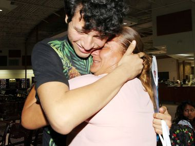 Francisco Galicia, 18, embraced his mother Sanjuana Galicia at the McAllen Central Station on Wednesday, July 24, 2019. Galicia was born in Dallas and is a U.S. citizen, but federal authorities detained him for more than three weeks for deportation proceedings before he was released without explanation Tuesday.