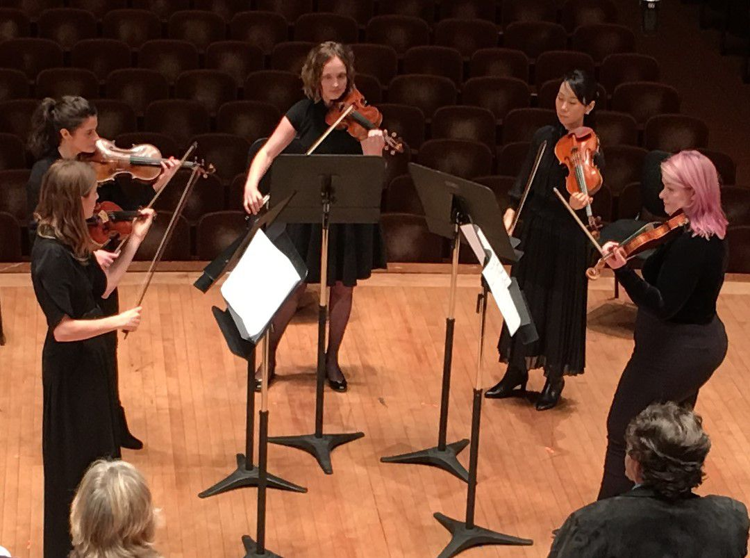 """Dallas Symphony Orchestra violinists Lydia Umlauf, Mariana Cottier-Bucco, Paige Kossuth, Kaori Yoshida and Nora Scheller perform Julia Wolfe's With a blue dress on in a """"Musician's View"""" concert April 8, 2019 at the Meyerson Symphony Center. The concert was part of the DSO's 2019 Soluna International Festival of Music and Arts. (Scott Cantrell/Special Contributor)"""