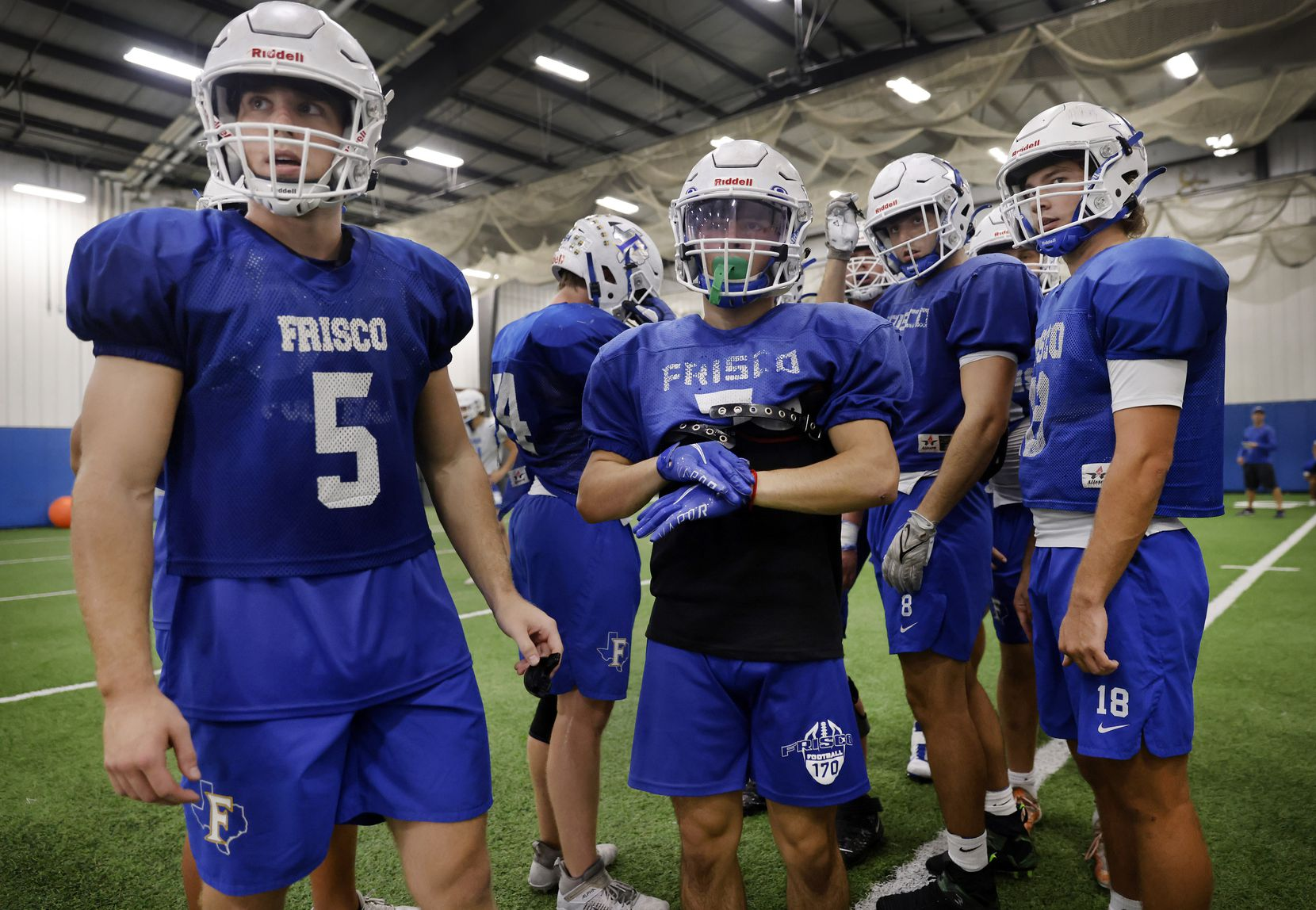 Frisco High running backs Bradford Martin (left), Dylan Hardin (center) and quarterback Wyatt Carson (right) listen for the next play to run during practice at the school's indoor facility in Frisco, Texas, Wednesday, October 13, 2021. (Tom Fox/The Dallas Morning News)
