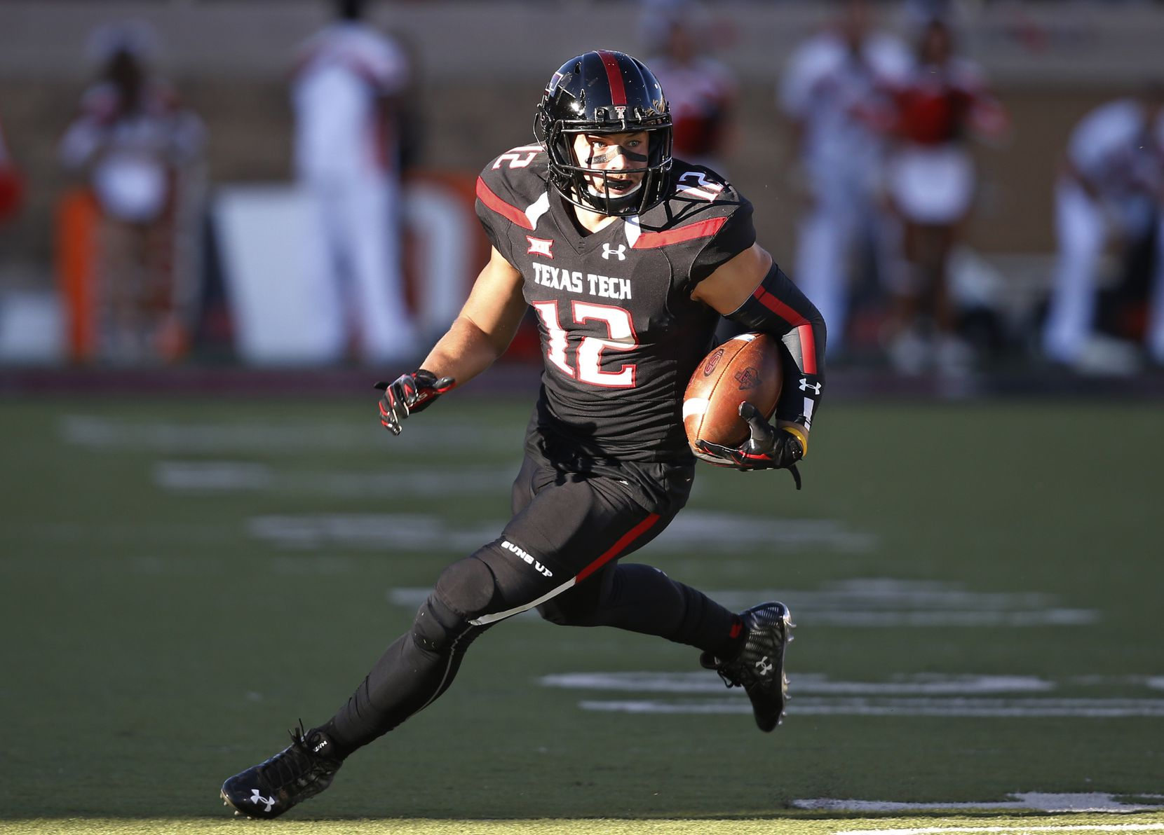 FILE - In this Oct. 31, 2015, file photo, Texas Tech wide receiver Ian Sadler carries the ball during an NCAA college football game against Oklahoma State in Lubbock, Texas. No one is saying Sadler (42 catches for 596 yards and three touchdowns) needs to double his production and make up for what Jakeem Grant did alone. But Mahomes will need reliable slot guys who can turn a short gain into a big one occasionally and either Sadler or Cameron Batson will be asked to fill that role. (AP Photo/Sue Ogrocki, File)