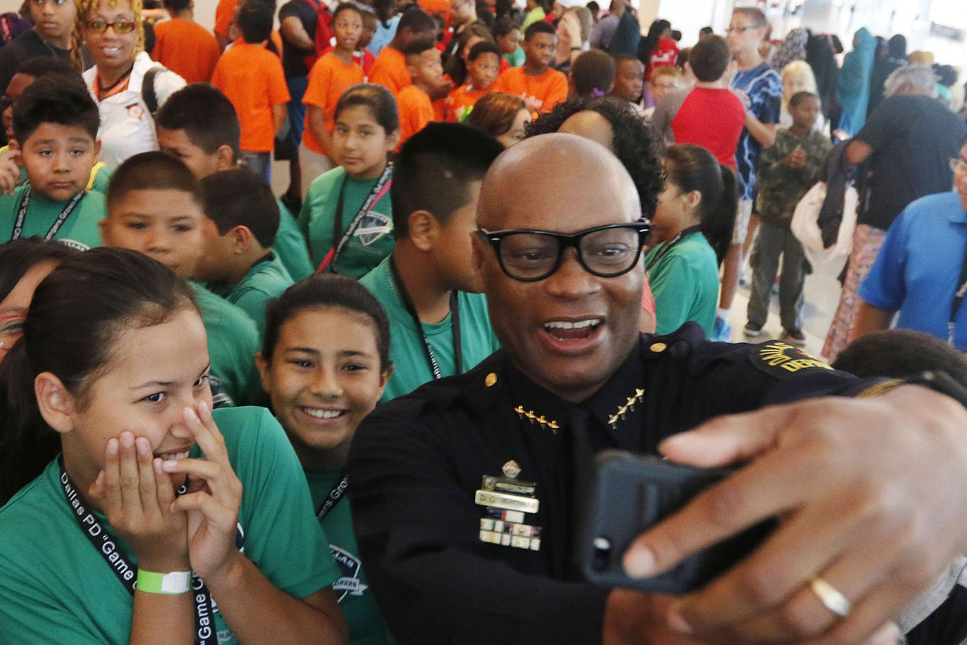 """Dallas Chief of Police David Brown takes a selfie with a group of kids during """"Let's Talk,"""" a youth forum to discuss how teens should interact with cops and other issues at Kay Bailey Hutchison Convention Center in Dallas on Tuesday, August, 4, 2015."""