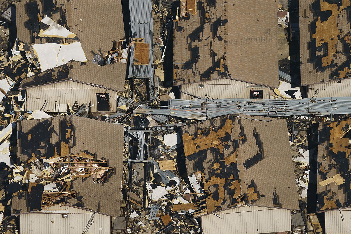 Temporary classroom are seen buried in rubble at Thomas Jefferson HIgh School in an aerial view of tornado damage on Monday, Oct. 21, 2019, in Dallas. (Smiley N. Pool/The Dallas Morning News)