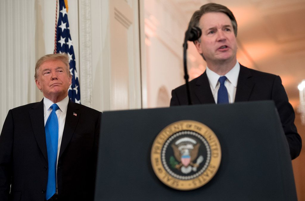US Judge Brett Kavanaugh speaks after being nominated by US President Donald Trump (L) to the Supreme Court in the East Room of the White House on July 9, 2018 in Washington, DC.
