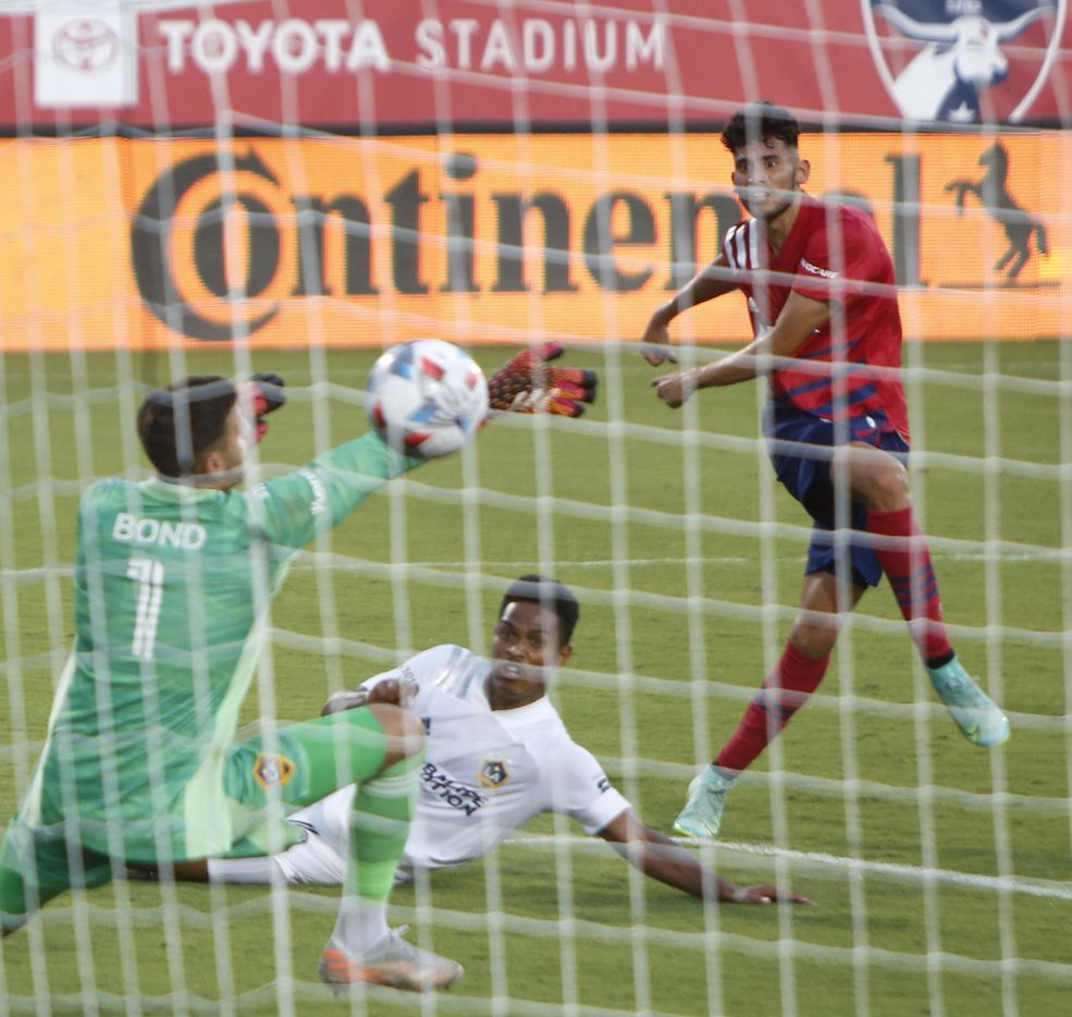 FC Dallas forward Ricardo Pepe (16), right, fires a shot past LA Galaxy goalkeeper Jonathan Bond (1) for his second goal during first half action. The two teams played their MLS match at Toyota Stadium in Frisco on July 24, 2021. (Steve Hamm/ Special Contributor)