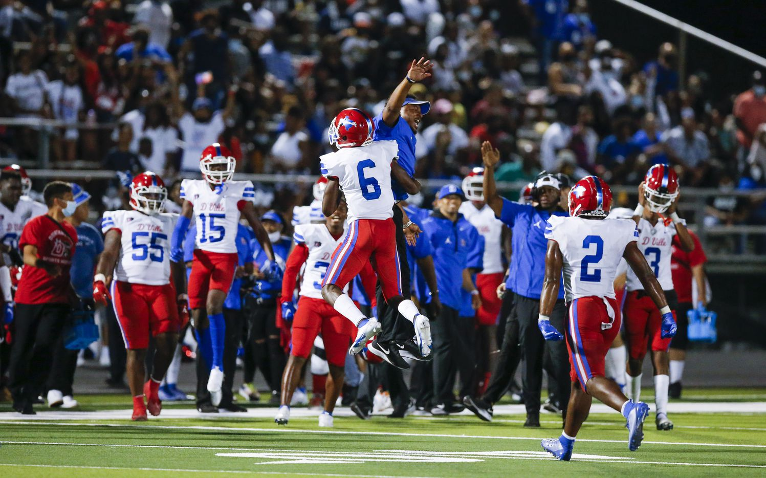 Duncanville senior Da'Myrion Colemman (6) celebrates with coaches and teammates after coming up with a DeSoto fumble on a punt return during the second half of a high school football game at DeSoto High School, Friday, September 17, 2021. Duncanville won 42-21. (Brandon Wade/Special Contributor)