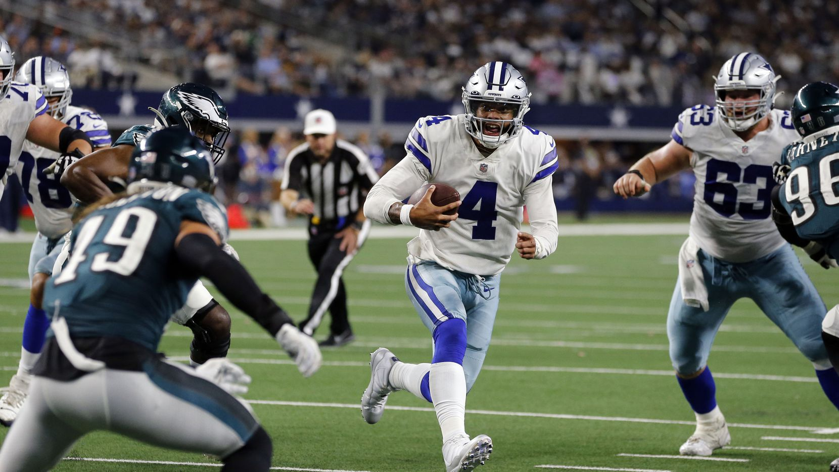 Dallas Cowboys quarterback Dak Prescott (4) scrambles to the two-yard-line during the second half of a NFL football game against the Philadelphia Eagles High at AT&T Stadium in Arlington on Monday, September 27, 2021.