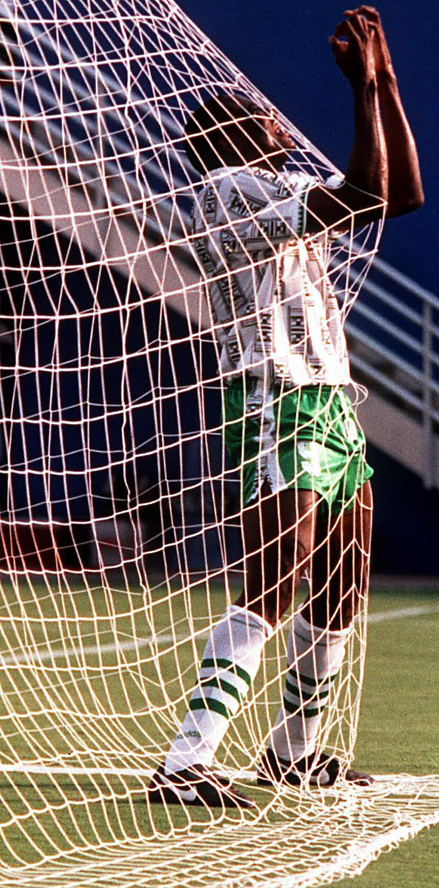 Nigeria's Rashidi Yekini celebrates in the net after scoring his nation's first goal of their game against Bulgaria during their World Cup game at the Cotton Bowl in June 1994.