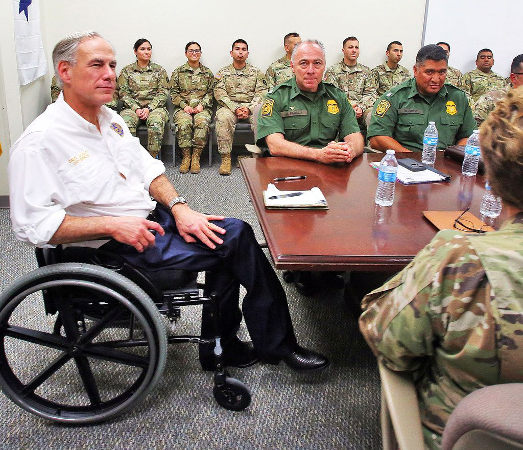 Texas Gov. Greg Abbott, left, talks with leaders of the Texas National Guard and the U.S. Border Patrol at the Texas National Guard Armory on Thursday, April 12, 2018, in Weslaco. Governor Abbott announced that there will be an increase of 1000 Texas National Guard on the southern border with Mexico.  (Joel Martinez/The Monitor via AP)