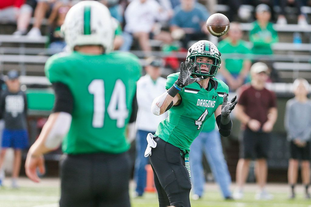 TXHSFB Southlake Carroll senior quarterback Will Bowers (14) throws to senior running back TJ McDaniel (4) during the first half of a Class 6A Division I area-round playoff high school football game against DeSoto at Newsom Stadium in Mansfield, Saturday, November 24, 2018. (Brandon Wade/Special Contributor)