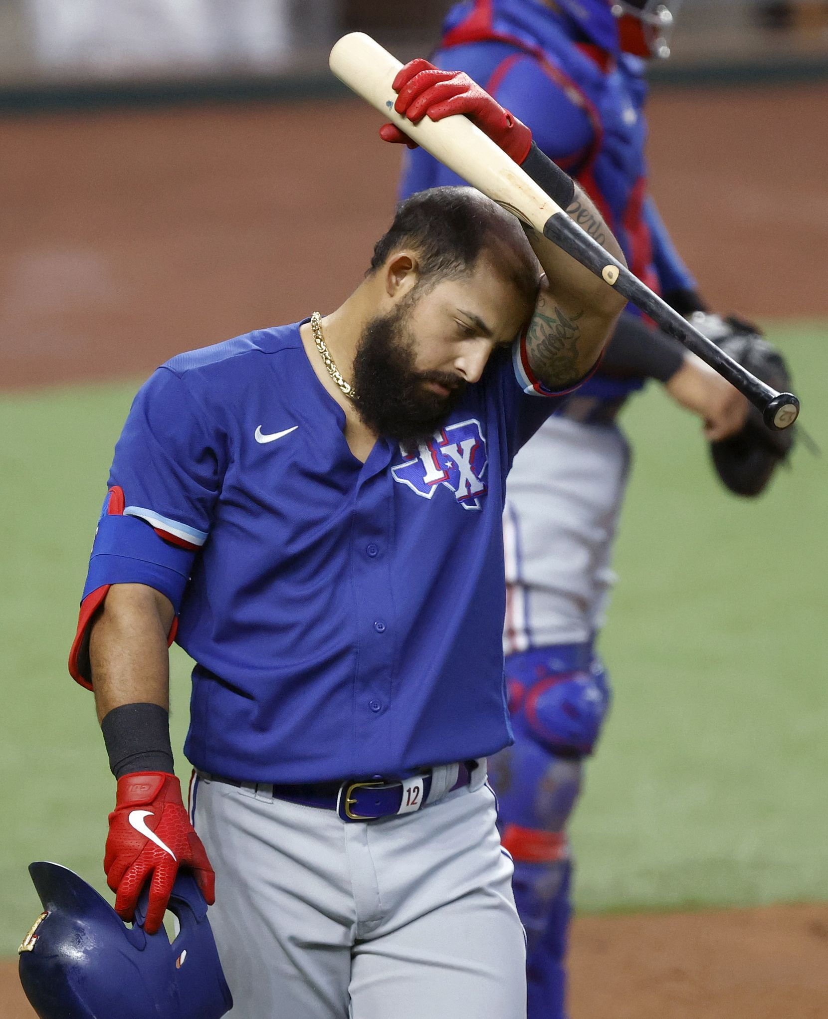 Texas Rangers batter Rougned Odor wipes his brow between pitches during a simulated Summer Camp game inside Globe Life Field in Arlington, Texas, Thursday, July 9, 2020. (Tom Fox/The Dallas Morning News)