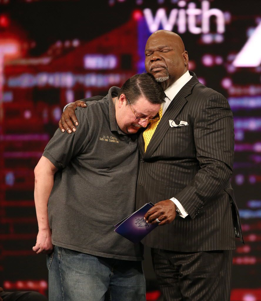 In this 2016 file photo, Dallas County Sheriff's Lt. Steven Gentry is hugged by Bishop T.D. Jakes during a town hall on police and racial tensions at The Potter's House in Dallas.