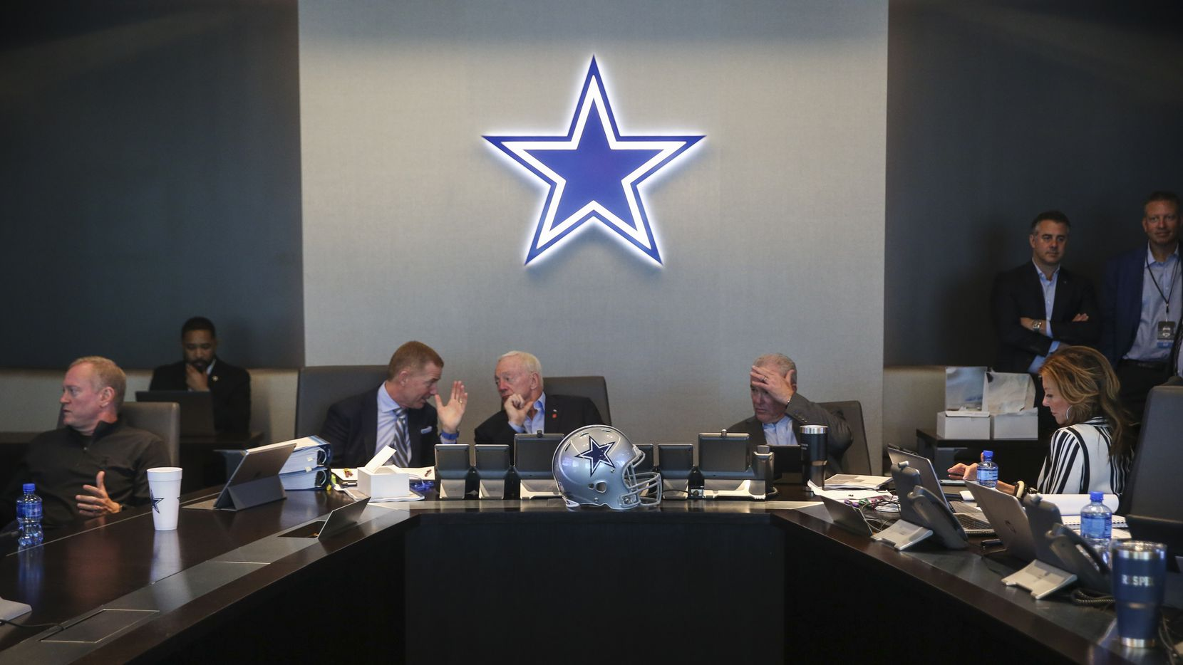 Dallas Cowboys Head Coach Jason Garrett, left, Owner Jerry Jones, and Chief Operating Officer Stephen Jones head the table in The War Room during the first round of the NFL Draft on Thursday, April 25, 2019 at The Star in Frisco, Texas.