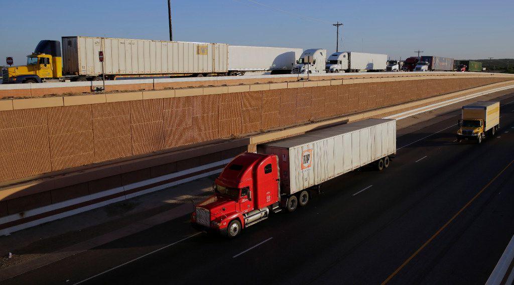 Trucks move along Interstate 35 in Laredo.