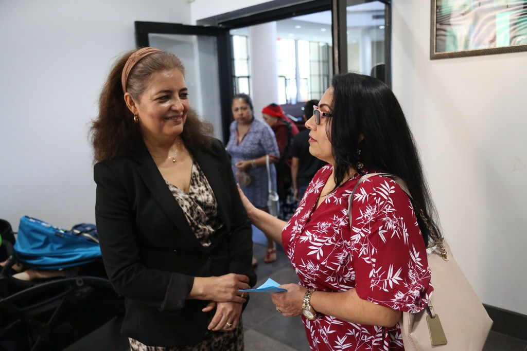 Dallas Area Interfaith organizer Socorro Perales (left) and churchgoer Maria De Jesus Fuerte discussed an upcoming political event after mass at Nuestra Se ora Del Pilar Catholic Church in Dallas on Sunday.