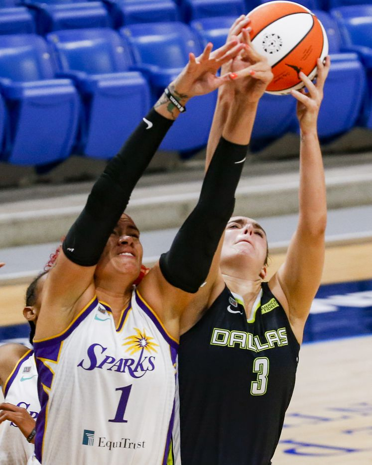 Dallas Wings guard Marina Mabrey (3) fights Los Angeles Sparks center Amanda Zahui B (1) for the rebound during the second quarter at College Park Center on Tuesday, June 1, 2021, in Arlington. (Juan Figueroa/The Dallas Morning News)