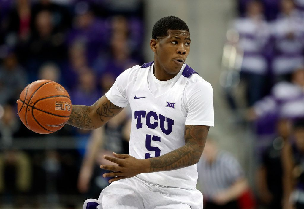 TCU guard Kendric Davis (5) handles the ball during an NCAA college basketball game against Kansas State in Fort Worth, Texas, Monday, March 4, 2019. (AP Photo/Tony Gutierrez)