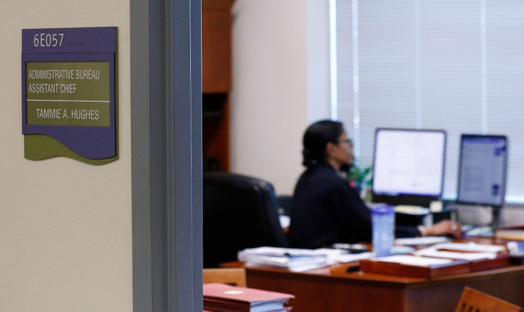 "Assistant Chief Tammie Hughes, in her office at Dallas Police Department headquarters, takes five-minute ""brain breaks"" to"