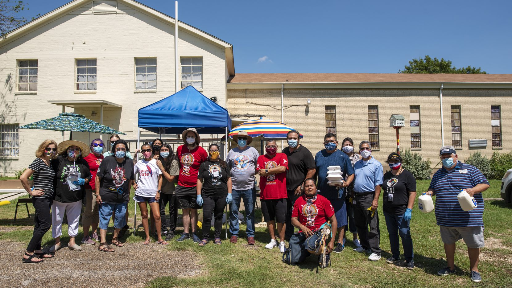 "Native people and volunteers for the American Indian Heritage Day in Texas posed outside Dallas Indian Mission United Methodist Church during a community awareness event in Dallas on Saturday. The event provided information about COVID-19 and the 2020 census and registered people to vote. Of Native Americans living in the Dallas-Fort Worth area today, Pat Peterson, a citizen of the Choctaw Nation of Oklahoma whose family moved to Texas decades ago, said for this story: ""We are a community, but we are scattered. We're all over North Texas."""
