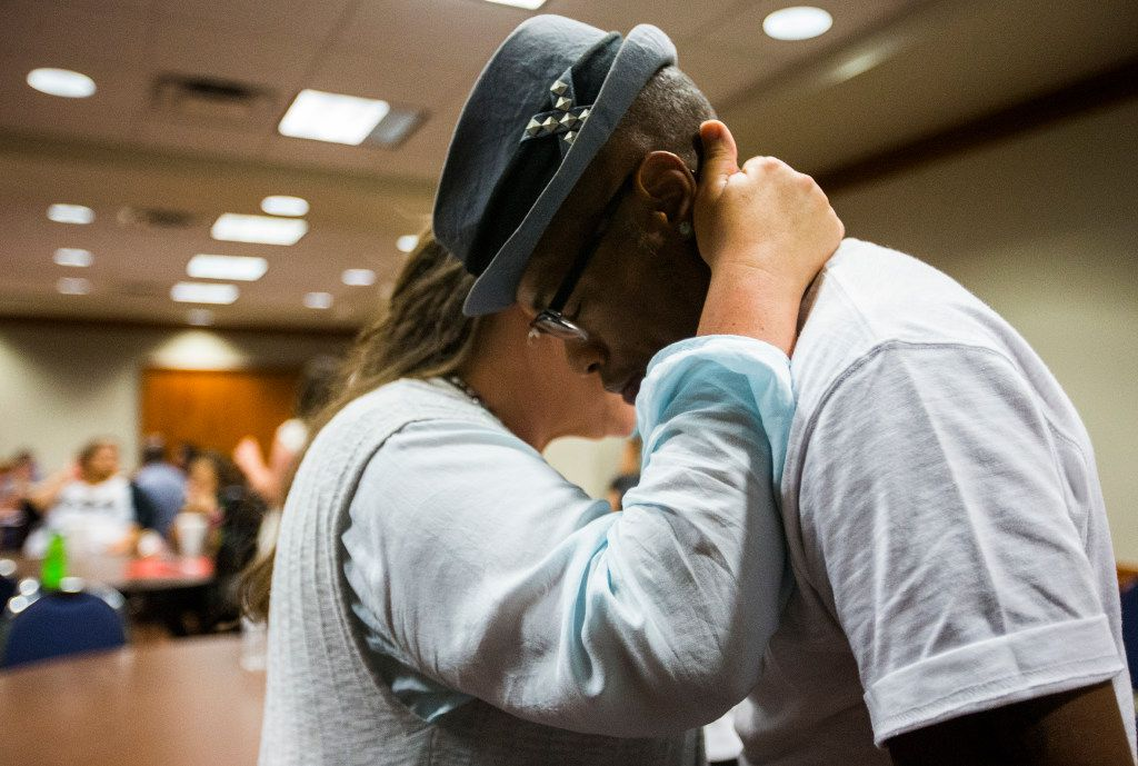 Clergy member Kimberley Shappley, left, of Pearland, Texas prays with Pascha Morgan of Copperas Cove, Texas after an interfaith prayer service in a hospitality room for people who came to speak against the bathroom bill at a public hearing on the fourth day of a special legislative session on Friday, July 21, 2017 at the Texas state capitol in Austin, Texas. (Ashley Landis/The Dallas Morning News)