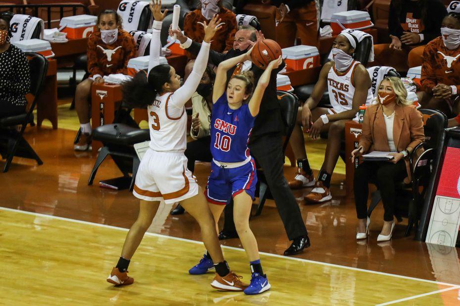 SMU's Rhyle McKinney (10) tries to complete a pass over Texas' Karisma Ortiz (3) during a game in Austin on Wednesday, Nov. 25, 2020. (Lola Gomez/American-Statesman)
