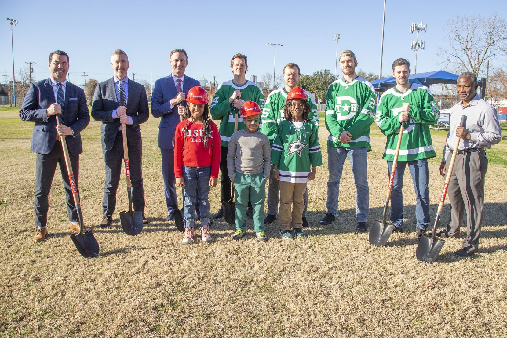 The Stars Foundation named St. Philip's School and Community Center the beneficiary of its Winter Classic Legacy project, committing $2 million over five years. A portion of the $2 million will go to a new multisport athletic complex. Shown with St. Philip's students at a groundbreaking ceremony on Dec. 31, 2019 are (from left) Stars Foundation president Marty Turco, NHL executive VP of marketing Brian Jennings, Stars CEO Brad Alberts, Stars forward Denis Gurianov, goaltender Anton Khuodobin, defenseman Jamie Oleksiak, center Jason Dickinson and St. Philip's headmaster Dr. Terry Flowers.