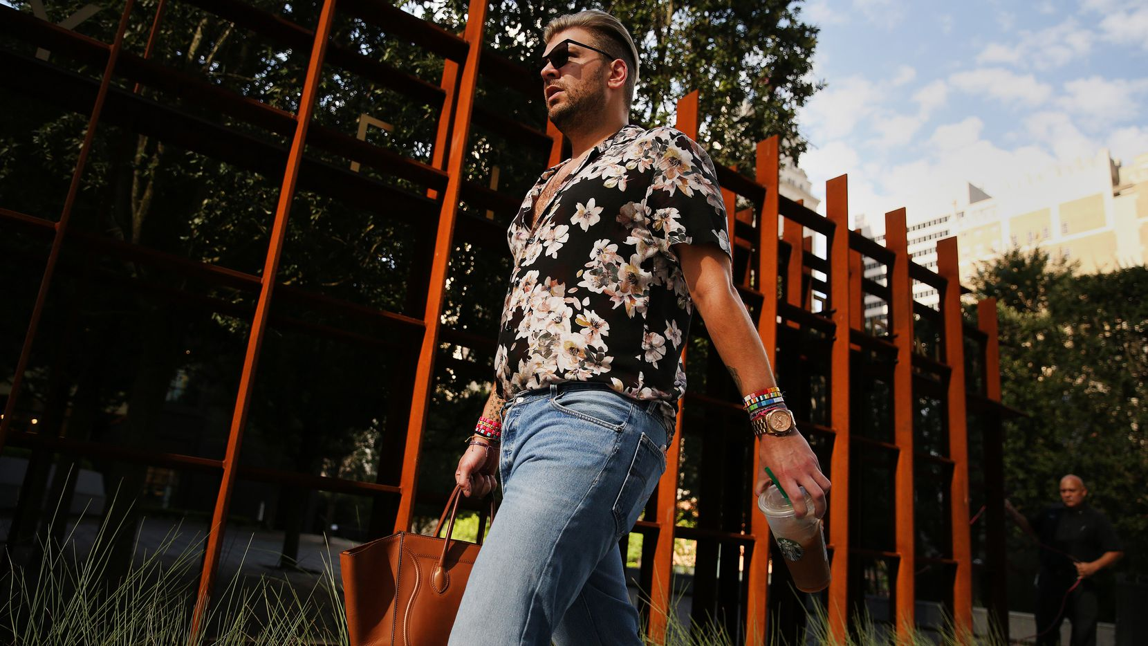 Reed Robertson, of Dallas, walks to work at Forty Five Ten along Elm Street while The Dallas Morning News takes a look at style and fashion in the Dallas central business district Tuesday July 11, 2017.