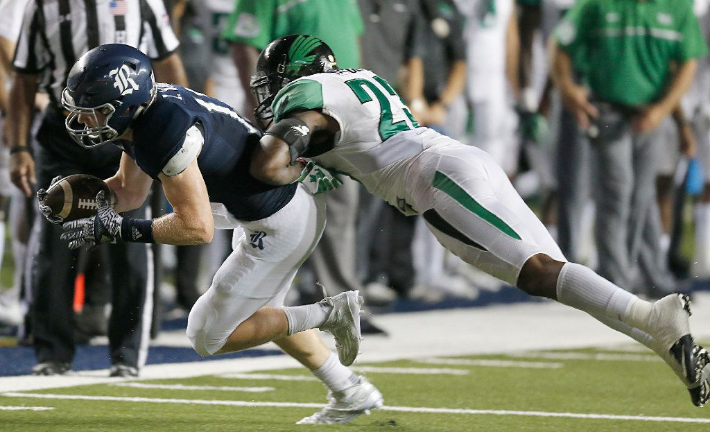 HOUSTON, TX - SEPTEMBER 24: Wide receiver Zach Wright #17 of the Rice Owls is tackled by defensive back Kishawn McClain #23 of the North Texas Mean Green in the second half at Rice Stadium on September 24, 2016 in Houston, Texas.  North Texas Mean Green won 42 to 35 in double over time. (Photo by Thomas B. Shea/Getty Images)