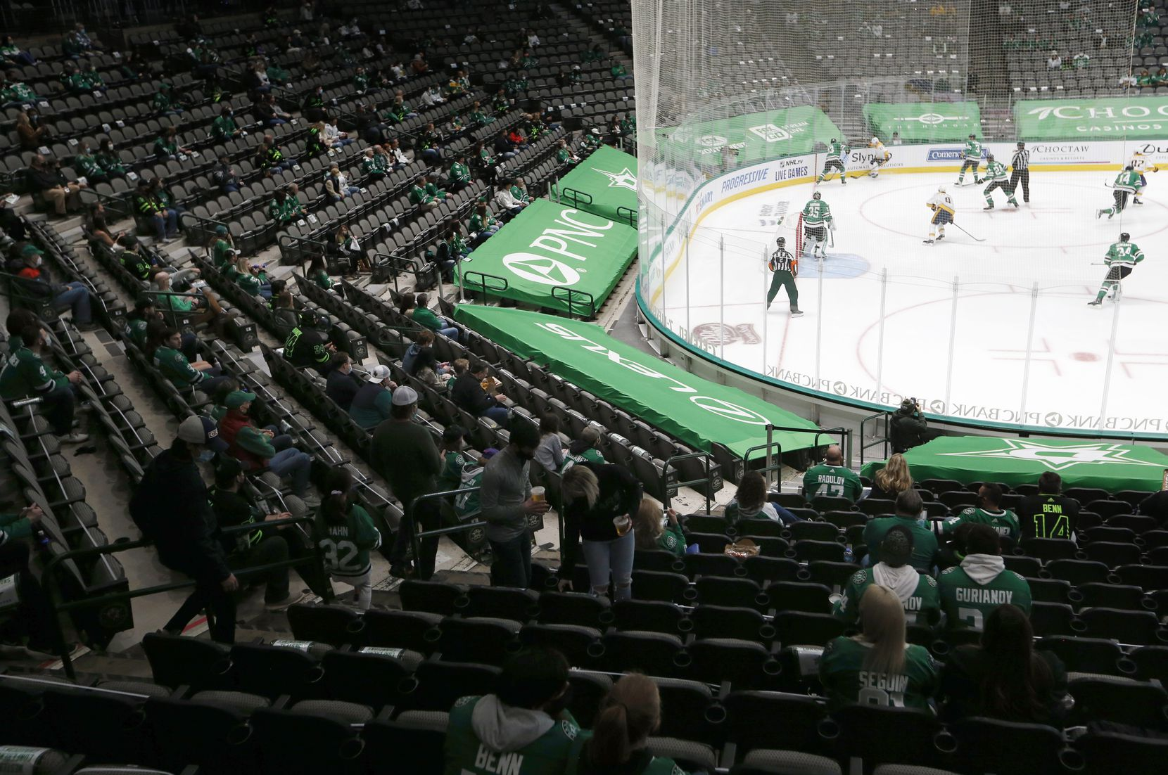 Dallas Stars fans watch as the Dallas Stars play against the Nashville Predators during the first period of play in the home opener at American Airlines Center on Friday, January 22, 2021in Dallas. (Vernon Bryant/The Dallas Morning News)