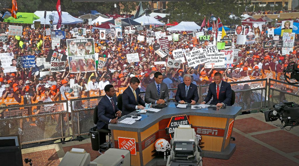 L to R, ESPN analyst Desmond Howard, host Rece Davis,, contributor David Pollack, analyst Lee Corso and analyst Kirk Herbstreit film their live College Gameday show as fans hold signs in the background prior to the Texas A&M vs. Tennessee game at Kyle Field in College Station, Texas, Saturday, Oct. 8, 2016. (Jae S. Lee/The Dallas Morning News)
