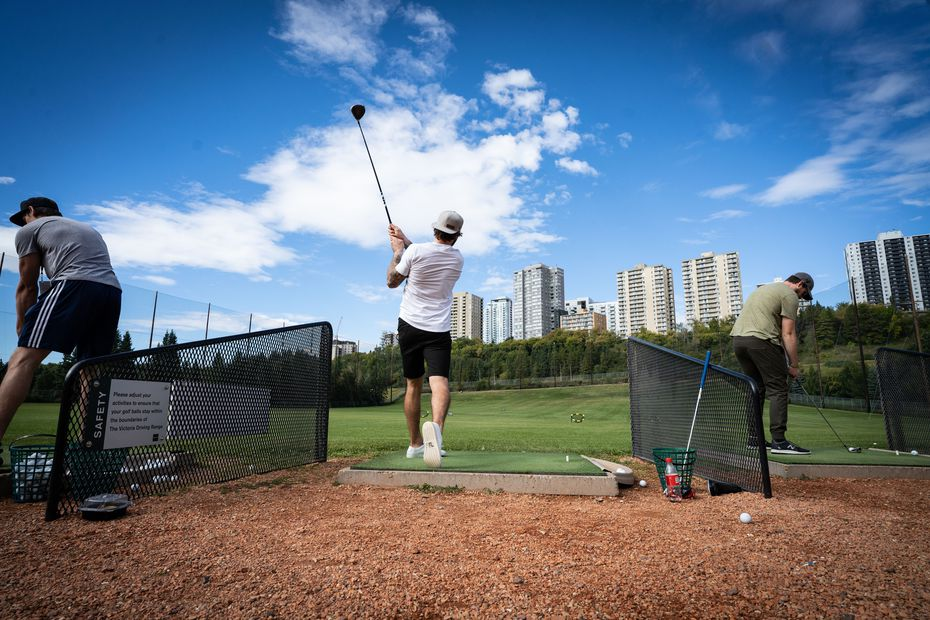 Dallas Stars player Tyler Seguin (middle) tees off on a driving range on Sept. 9, 2020 during a break from the ice in Edmonton, Alberta.