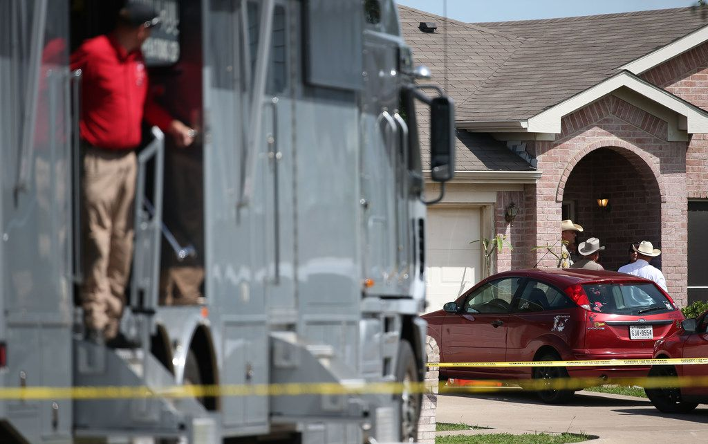 Denton County Sheriff's officers investigate a crime scene where five people were killed and one was hospitalized after a shooting at a home in the Remington Park neighborhood of Ponder.
