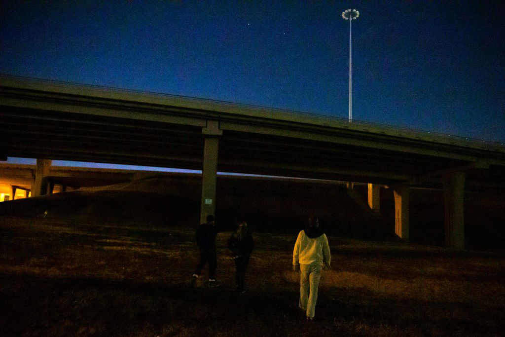 Ben Bailey walks under a bridge with Hope Stedman and Ikenna Mogbo during the annual homeless count in Dallas on Thursday, Jan. 24, 2019.