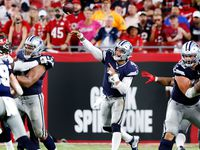 Dallas Cowboys quarterback Dak Prescott (4) throws a deep third quarter pass to wide receiver CeeDee Lamb (88), only to have it intercepted at Raymond James Stadium in Tampa, Florida, Thursday, September 9, 2021.