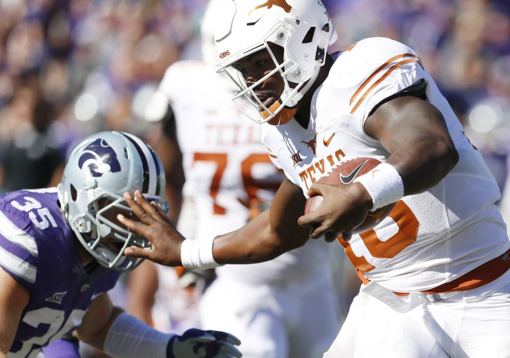 Texas quarterback Tyrone Swoopes (18) brushes aside Kansas State linebacker Will Davis (35) as he heads for the end zone and a touchdown at Snyder Family Stadium in Manhattan, Kan., on Saturday, Oct. 22, 2016. Kansas State won, 24-21. (Bo Rader/Wichita Eagle/TNS)