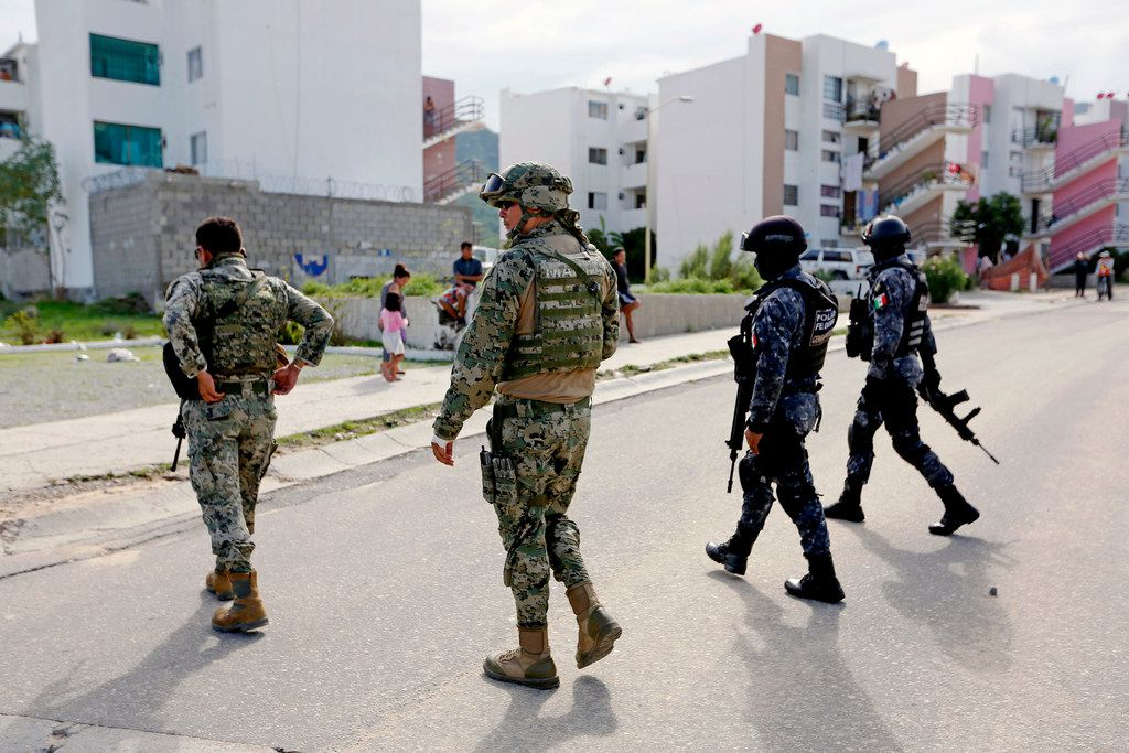 The Mexican Federal Police, Mexican Army and local municipal police respond to a shooting at a home in colonia Puerto Nuevo in San Jose del Cabo, Baja California Sur.