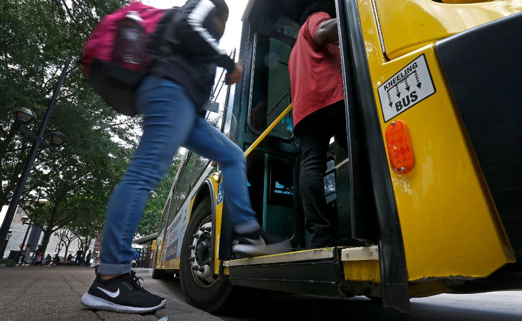 People board a DART bus at West Transfer Center in Dallas, Thursday, April 20, 2017.
