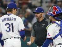 Texas Rangers manager Chris Woodward (8) removes Texas Rangers starting pitcher Spencer Howard (31) from the game during the third inning against the Los Angeles Angels at Globe Life Field on Thursday, Aug. 5, 2021, in Arlington.
