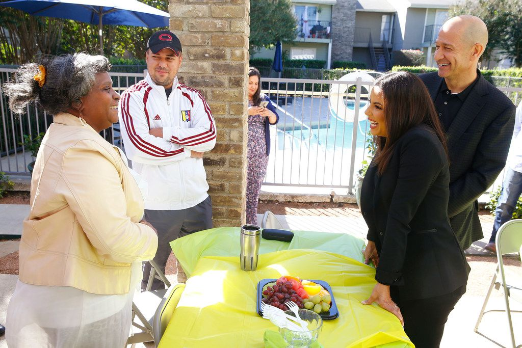 Eva Longoria talks to legends on Lake Highlands residents Lena Carroll and Aldrint Villarroel as she visited the complex with Bobby Turner, principal and chief executive officer, on Thursday.