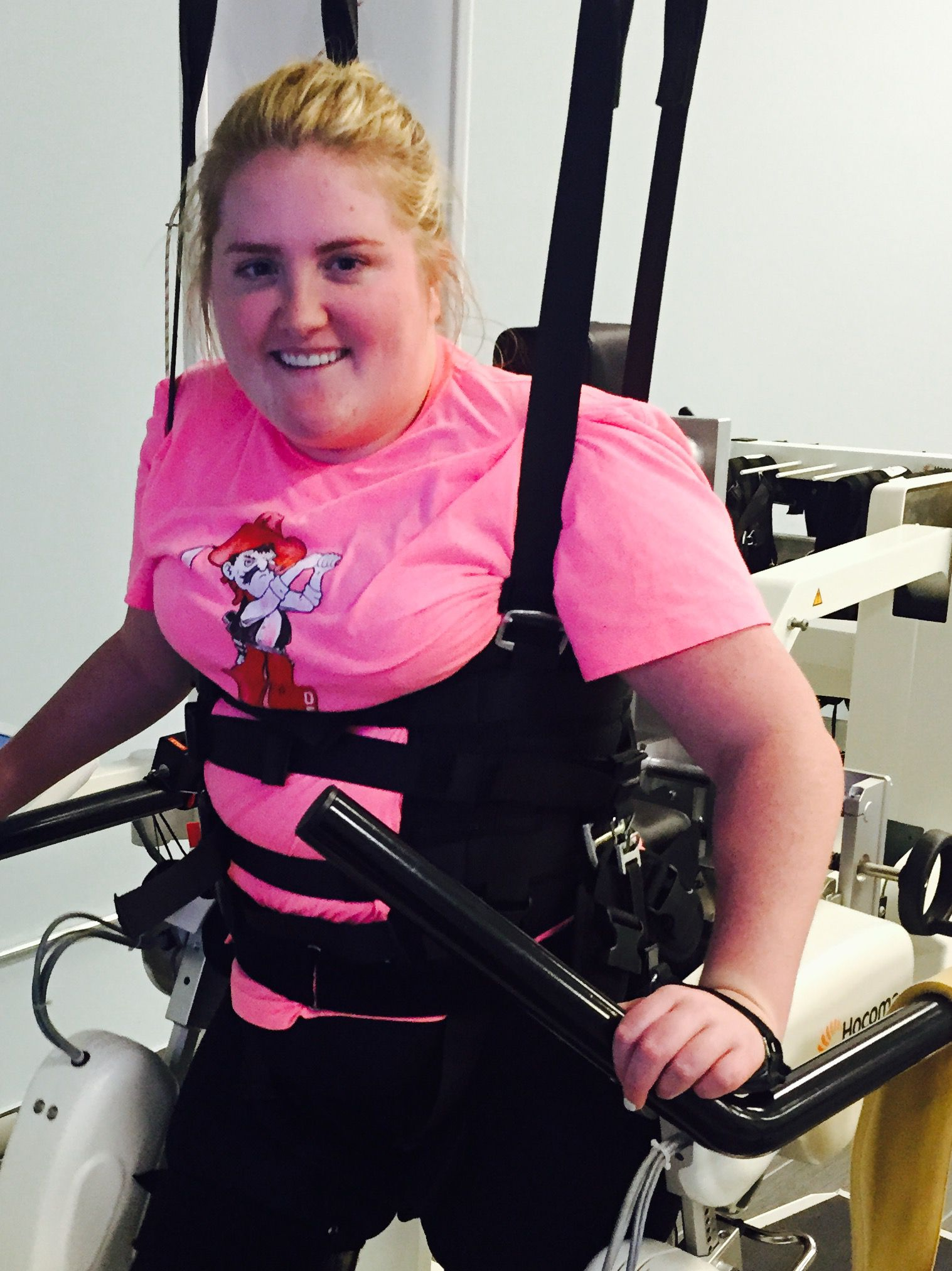 Sarah Milburn, 24, at physical therapy. She was paralyzed after the Uber van she was riding in crashed into another vehicle. She has some use of her hands and arms but is paralyzed from mid-chest down.