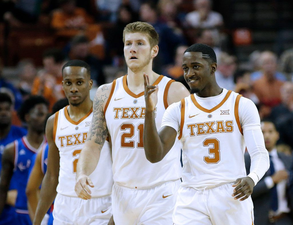 AUSTIN, TEXAS - JANUARY 29: (L to R) Matt Coleman III #2, Dylan Osetkowski #21 and Courtney Ramey #3 of the Texas Longhorns walk to the bench during the game with the Kansas Jayhawks at The Frank Erwin Center on January 29, 2019 in Austin, Texas. (Photo by Chris Covatta/Getty Images)