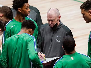 Dallas Mavericks head coach Rick Carlisle works with his team during the first half of an NBA basketball game against the Sacramento Kings at American Airlines Center on Sunday, May 2, 2021, in Dallas.