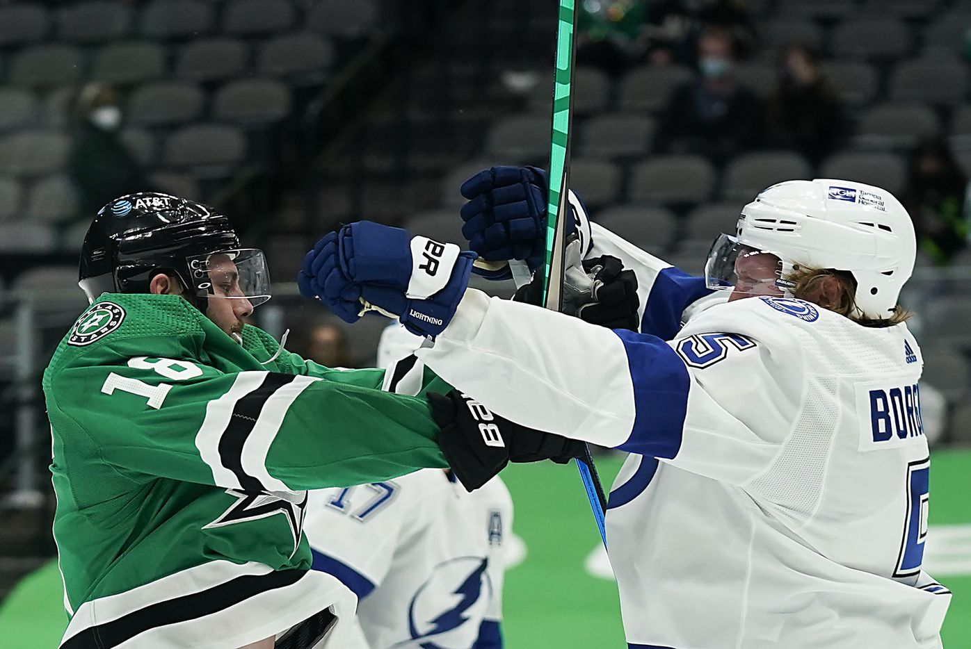 Dallas Stars center Jason Dickinson (18) tussles with Tampa Bay Lightning defenseman Andreas Borgman (5) during the first period of an NHL hockey game at the American Airlines Center on Thursday, March 25, 2021, in Dallas. (Smiley N. Pool/The Dallas Morning News)