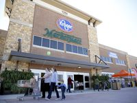 Shoppers walk through the entrance of the new Kroger Marketplace in Prosper.