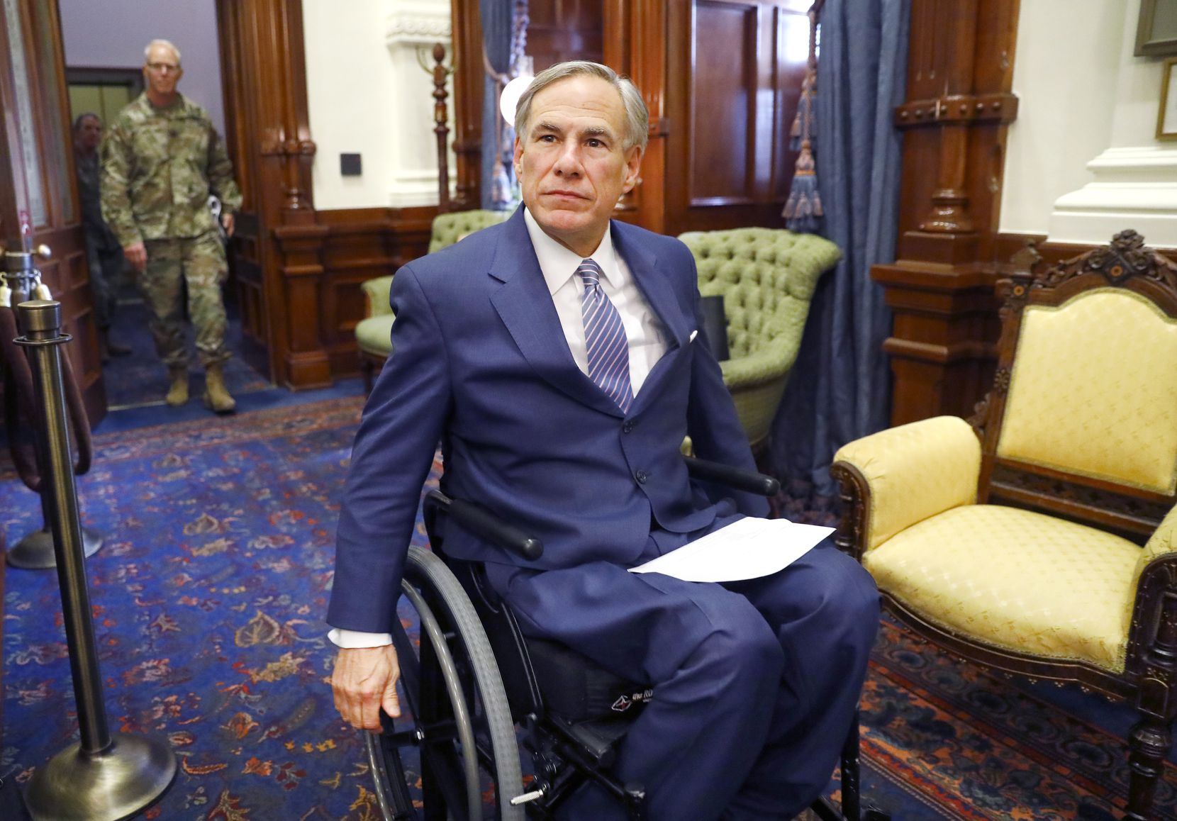 Gov. Greg Abbott, shown entering a March 29 coronavirus news briefing, faces blowback from his party's right wing over his use of the Texas Disaster Act of 1975 to order closures and other COVID-19 precautions. House Republicans have prefiled a dozen measures that would trim a Texas governor's emergency powers.