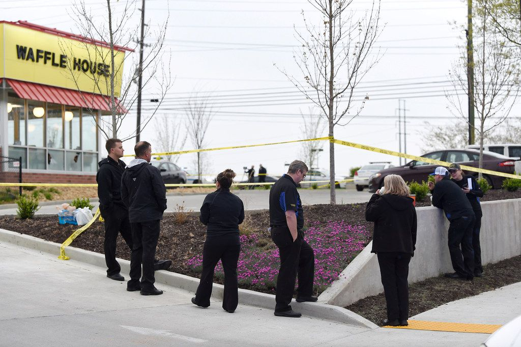 Law enforcement officials work the scene of a fatal shooting at a Waffle House in the Antioch neighborhood of Nashville.