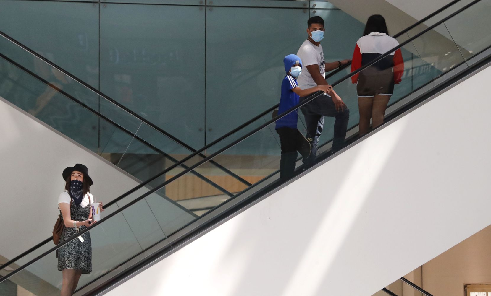 Amid concerns of the spread of COVID-19, shoppers wear masks inside the Galleria Dallas mall on May 4.