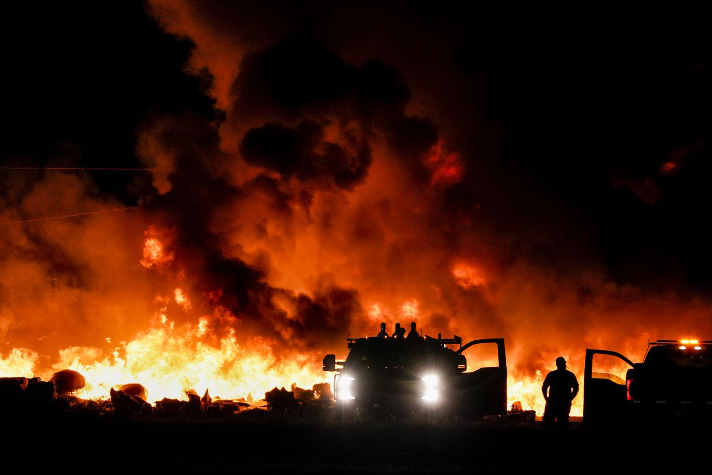 Fire crews battle a massive blaze in an industrial area of Grand Prairie in the early morning hours of Wednesday, Aug. 19, 2020.