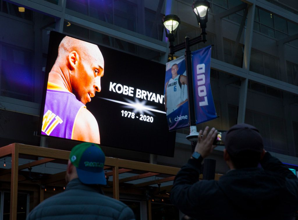 Large screens display a tribute to former Los Angeles Laker Kobe Bryant and his daughter, GiannaBryant, before an NBA game between the Dallas Mavericks and the Phoenix Suns on Tuesday, January 28, 2020 at the American Airlines Center in Dallas.