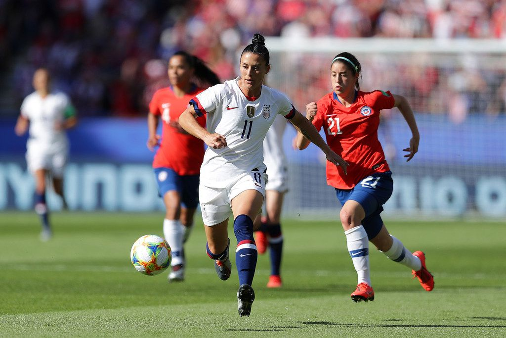 Ali Krieger of the United States runs with the ball under pressure from Rosario Balmaceda, right, of Chile during a FIFA Women's World Cup group match at Parc des Princes in Paris on June 16, 2019. (Richard Heathcote/Getty Images/TNS) **FOR USE WITH THIS STORY ONLY**